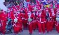 Madrid, in diecimila alla corsa dei Babbo Natale